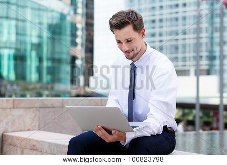 Young Businessman read on the laptop computer