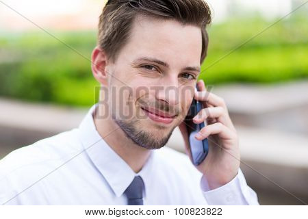 Caucasian young businessman chat on mobile phone