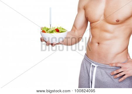Fitness man holding a bowl of salad, isolated on white background