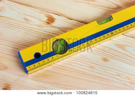 Construction Level on wooden background