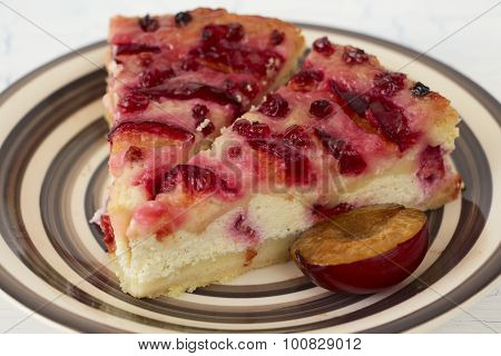 Plum Cheesecake Pieces And Half A Plum