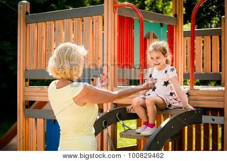 Grandmother with grandchild in playground