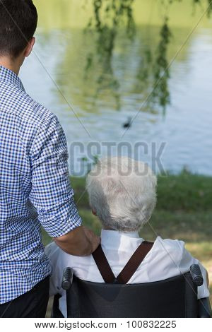 Young Grandson Helping His Grandfather