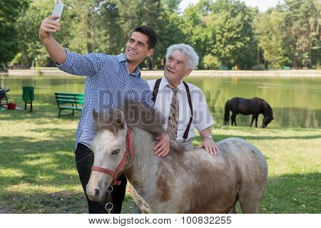 Man Taking Selfie With Grandfather