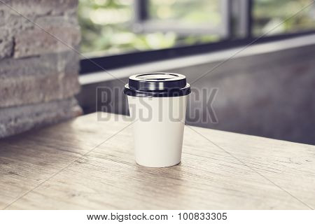Coffee To Go On A Wooden Table