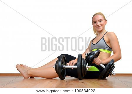 Girl  with dumbbells on white background