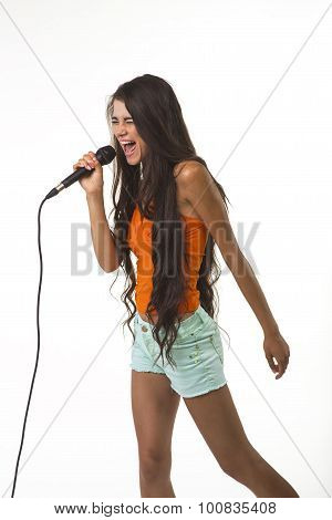 Mischievous lady in orange shirt with microphone.
