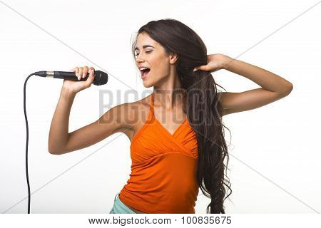 Pretty lady in orange shirt with microphone.