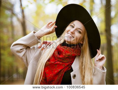 Fashionable Blond Woman At Beautiful Autumn Alley