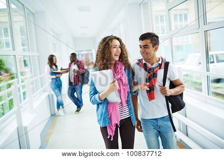 Happy high school learners interacting after classes