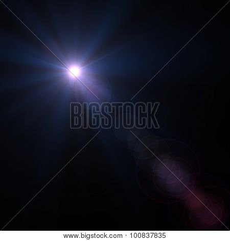 Lens flare effect over black background