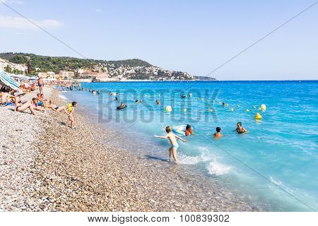 Tourists Enjoy The Good Weather At The Beach in Nice, F
