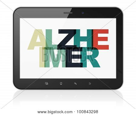 Healthcare concept: Tablet Computer with Alzheimer on  display
