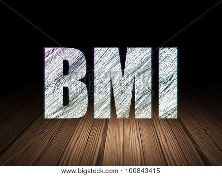 Healthcare concept: BMI in grunge dark room