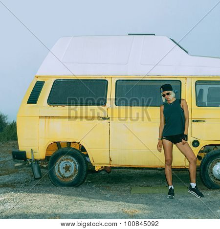 Stylish Girl Stands Near Vintage Minibus. Urban Fashion Style