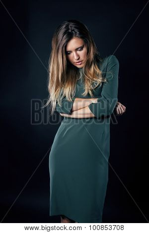 young blond woman emotional in depression dark indoor