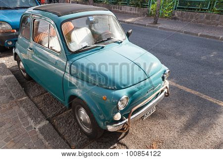 Old Green Fiat 500 City Car Stands Parked