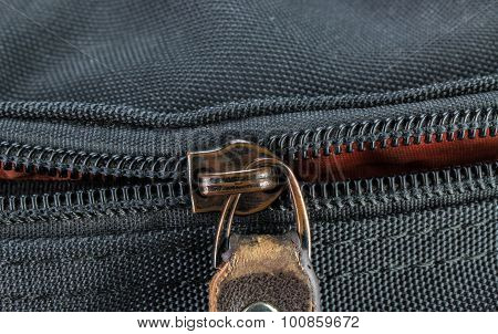 Old And Damaged Zipper On Black Cloth