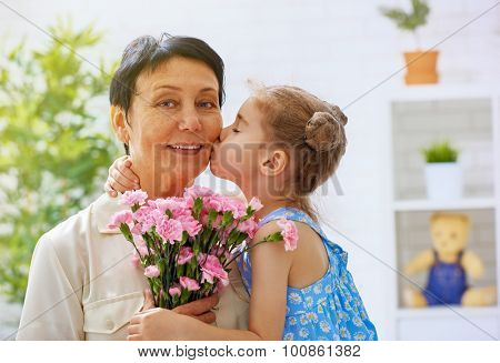 grandma and granddaughter with flowers