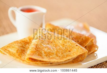 Tasty pancakes with sauce, breakfast