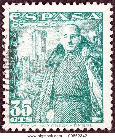 SPAIN - CIRCA 1948: A stamp printed in Spain shows General Franco and Castillo de la Mota
