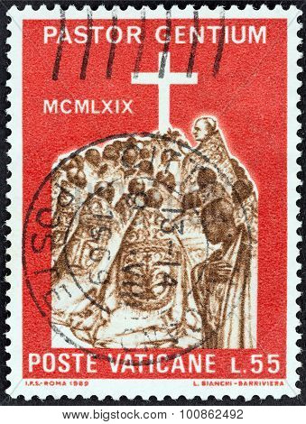 VATICAN CITY - CIRCA 1969: A stamp printed in Vatican City shows Pope with African bishops