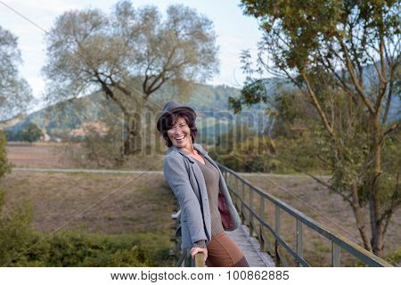 Confident Playful Happy Woman On A Footbridge