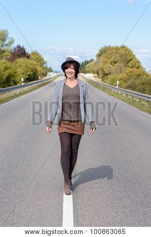 Stylish Modern Young Woman Walking Along A Road