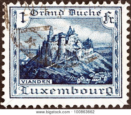 LUXEMBOURG - CIRCA 1921: A stamp printed in Luxembourg shows Vianden Castle
