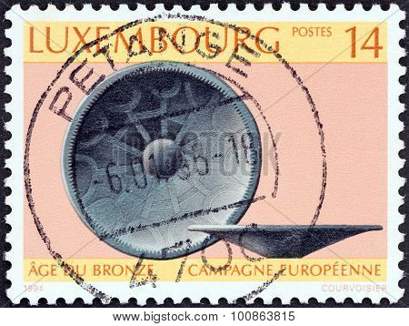 LUXEMBOURG - CIRCA 1994: A stamp printed in Luxembourg shows Bronze Age bowl