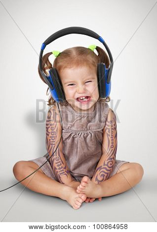 Funny Child Girl With Tatoo Listening Music With Headphones