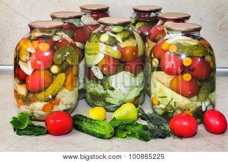 Glass bottles with canned vegetables.