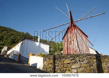 Red Rusty Windmill In Azores. Sao Jorge Island. Portugal