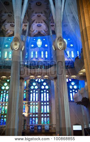 BARCELONA, SPAIN - MAY 02: Detail of Pillars and Stained Glass in Blue Light - Architectural Interior of Sagrada Familia Church, Designed by Antoni Gaudi, Barcelona, Spain. May 02, 2015.