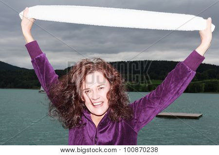 Attractive Young Woman Outdoors At A Lake