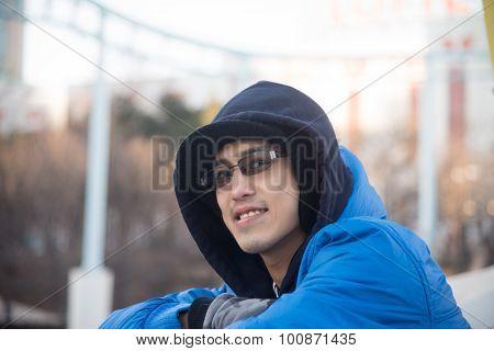 Asian Male In Hood Wear  Smile