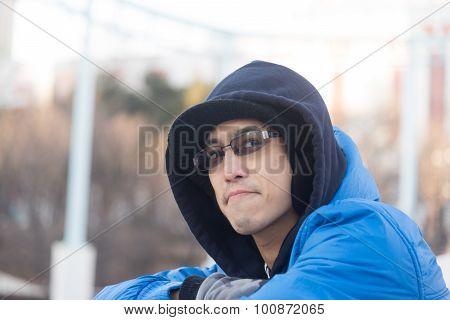 Asian Male In Hood Wear Sunglasses And  Smile