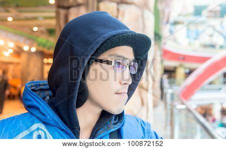 Asian Male In Hood Wear sunglasses Looking Forward  Alone