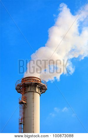 A single industrial chimney, blue sky