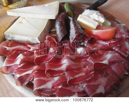 Typical South Tyrolean Snack With Speck, Mountain Cheese, Smoked Sausages And Mountain Butter