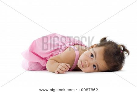 Little Girl Laying Down On The Floor