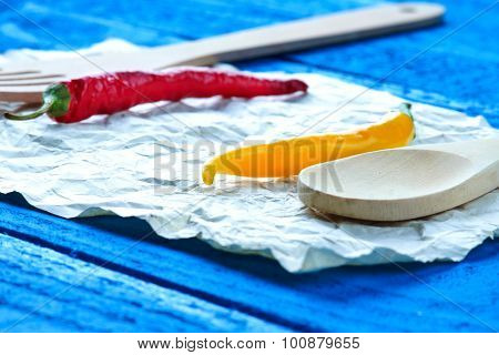 Kitchenware and chili pepper on a sheet of paper