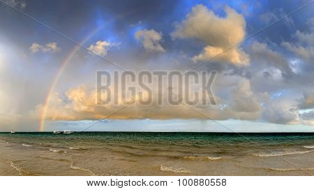 Boat And Rainbow In Ocean