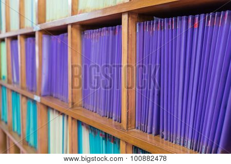 Documents aligned on the shelf