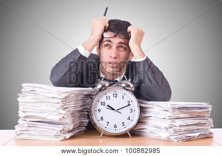 Woman businessman with giant alarm clock