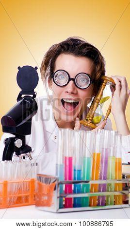 Crazy woman chemist in lab