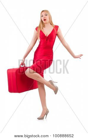 Blondie in red dress with suitcase isolated on white