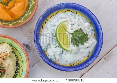 Tzatziki And Humus On A Wooden Table