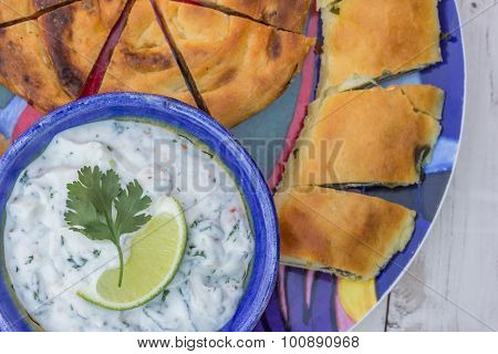 Greek Tzatziki And Pastry On A Colorful Plate