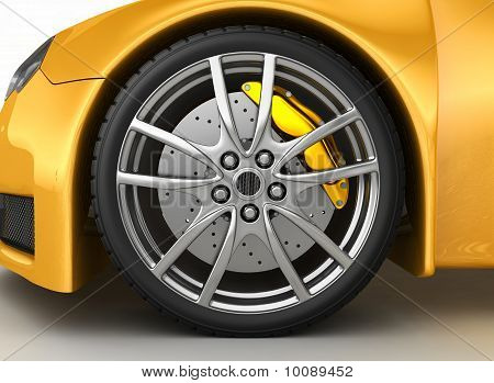 Front wheel of a bright yellow car